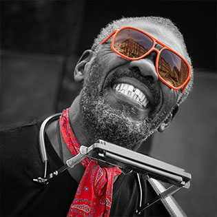 Black man with orange sunglasses